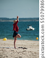 Portrait of woman making exercice on the beach 55079986