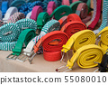 Closeup of colorfull cotton belts at the market 55080010