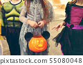 Little kid at a Halloween party 55080048