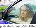 Sad woman and a rain 55084062