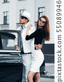 Young couple with a retro car 55089946