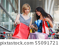 Young women with shopping cart 55091721