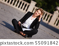 Young businesswoman with a folder 55091842