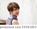 Happy young woman against a city fountain 55091852