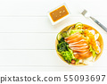 Raw fresh salmon fish meat sashimi with seaweed and other vegetables salad 55093697