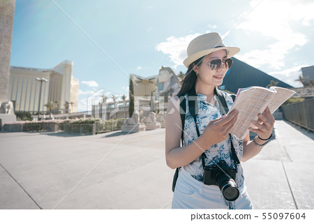woman tourist holding guide book read information 55097604