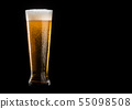 Glass of beer with foam on black background 55098508