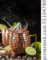Famous splashing Moscow mule alcoholic cocktail in copper mugs. 55104780