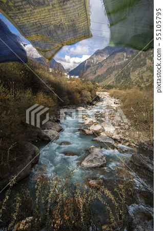 River flow pass valley in Himalaya with holy flag 55105795