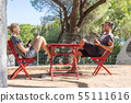 Couple on vacations resting in front of bungalow house at camping site in pure nature. Family 55111616