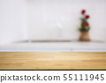empty wood table over blurred kitchen background 55111945