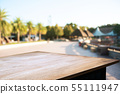 empty wood table in front of blurred montage home 55111947