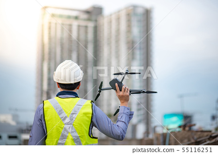 Asian engineer man using drone for site survey 55116251