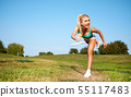 Fitness, young woman playing badminton in a city 55117483