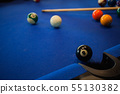 Billiard balls composition on blue pool table 55130382