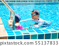 Cute little asian girl learning to swim with coach 55137833
