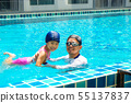 Cute little asian girl learning to swim with coach 55137837