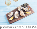 Fresh Oysters with lemon and white wine 55138356