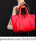 woman hand holds red handbag 55142338
