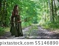 Elf archer from behind in the woods 55146890