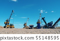 Mining equipment working. Working machines on a quarry, moving breakstones. 55148595