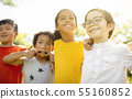 Multi-ethnic group of school kids laughing and 55160852