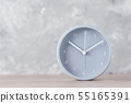 Classic alarm clock on a gray background 55165391