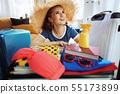 tourist woman with big beach straw hat preparing for summer trip 55173899