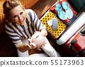 happy modern woman showing piggy bank planning budget trip 55173963