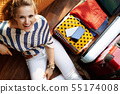 smiling elegant woman sitting with coffee cup 55174008
