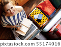 happy stylish woman planning holiday online 55174016