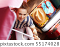 young woman with beach umbrella planning summer vacation 55174028