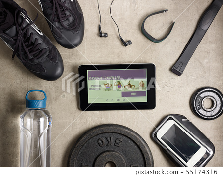 Closeup on tablet PC with personal trainer app 55174316