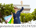 woman with shopping bags and smartphone waving with hand 55174720