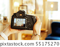 Closeup on DSLR camera in hand of female interior photographer 55175270