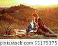 mother and child sitting on blanket and having family time 55175375