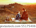 mother and child sitting on blanket and looking on each other 55175406