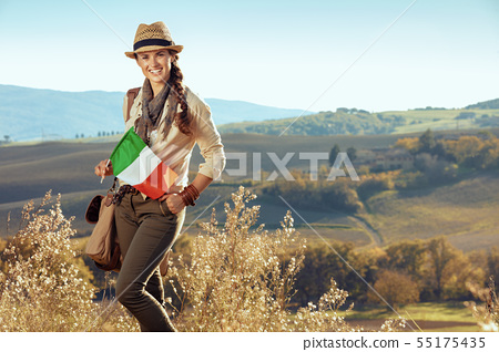 smiling fit solo traveller woman with Italian flag 55175435