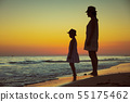 active mother and child on beach at sunset spending time 55175462