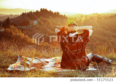 relaxed fit solo traveller woman sitting on blanket 55175523