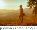 tourist woman on summer Tuscany trip looking into distance 55175533