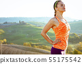 sports woman in front of scenery of Tuscany listening to music 55175542