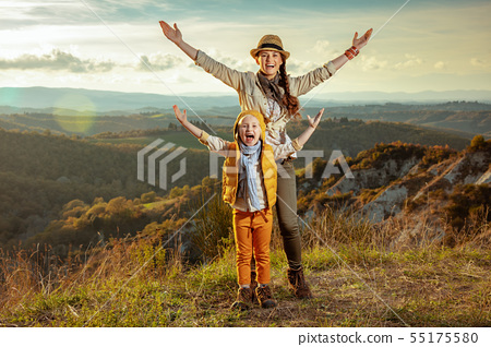 happy young mother and daughter in Tuscany ,Italy rejoicing 55175580