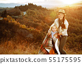 happy fit mother and child hikers enjoying summer Tuscany view 55175595