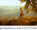fit solo traveller woman looking into distance 55175596