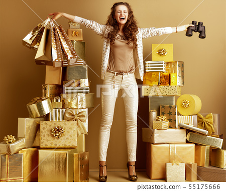 happy fashion-monger with shopping bags and binocular rejoicing 55175666