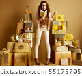 surprised elegant woman holding notebook making list of gifts 55175795