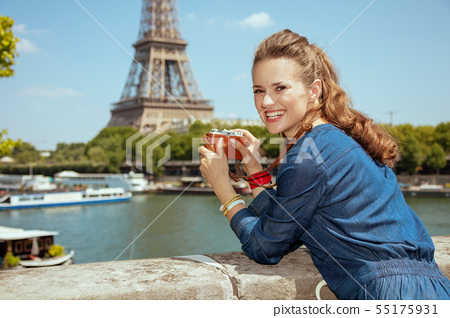 solo traveller woman taking photos with retro photo camera 55175931