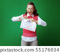 annoyed fit student woman tearing Certificate of Graduation 55176034