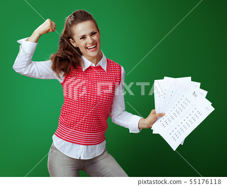 happy fit learner woman showing A+ test results and biceps 55176118